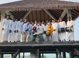 Bieber, 23, shared an image on Instagram of the duo posing with staff on a dock above the water, with Mallette sitting on a wheelchair on the first day of their luxury retreat, reports dailymail.co.uk. Surrounded by smiling staff dressed in all-white, Bieber is bent down on one knee and pointing toward the camera while wearing a bright yellow hoodie and comfortable grey sweatpants.