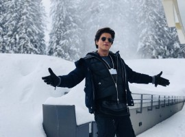 Superstar Shah Rukh Khan, who is in Davos to receive an honour at the 24th Annual Crystal Awards, recreated his signature open arms pose here in a middle of a snow clad path. Excited to be here, Shah Rukh tweeted an image of himself recreating the iconic pose and captioned it:
