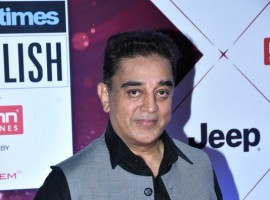 Kamal Haasan strikes a pose as he walks the red carpet at the HT India's Most Stylish Awards 2018