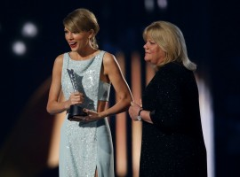 Taylor Swift accepts the Milestone Award from her mother Andrea at the 50th Annual Academy of Country Music Awards