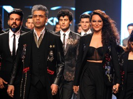 Indian Bollywood film director Karan Johar (L) and actress Sonakshi Sinha (R) showcase creations by designer Falguni Shane Peacock at the Lakmé Fashion Week (LFW) Summer Resort 2018 in Mumbai.