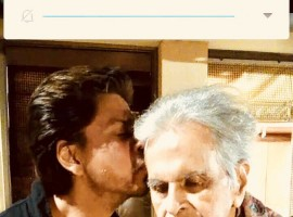 Superstar Shah Rukh Khan has visited Bollywood legend Dilip Kumar at his residence here. This was his second visit in six months. On Monday, Faisal Farooqui, a family friend of Dilip Kumar, took to the veteran actor's official Twitter account to share a photograph of Shah Rukh and the 95-year-old.  Shah Rukh is dressed in black, while a shawl is wrapped around a frail Dilip Kumar.