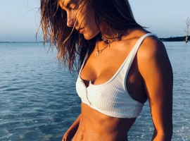 Alessandra Ambrosio flaunts her athletic figure and impressive abs.