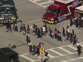 Students are evacuated from Marjory Stoneman Douglas High School during a shooting incident in Parkland, Florida.