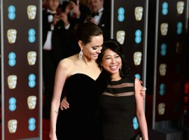 Angelina Jolie and Loung Ung attend the EE British Academy Film Awards (BAFTA) held at Royal Albert Hall on February 18, 2018 in London, England.