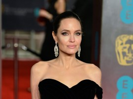 Actresses Angelina Jolie and Jennifer Lawrence outshined others as they glamourised the black dress code, followed by most at the 71st BAFTA red carpet here to support the Time's Up movement against sexual harassment and inequality.