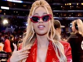 American rapper Cardi B flashes her cleavage in plunging jacket at NBA All-Star Game.
