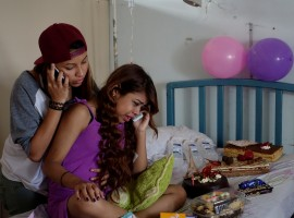Lismar Castellanos, 21, who lost her transplanted kidney, cries while she speaks on the phone with a relative during her birthday celebration at a state hospital in Caracas, Venezuela.