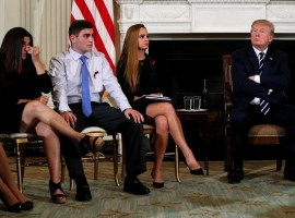 Parent Melissa Blank (L) and Marjory Stoneman Douglas High School shooting surviving students Jonathan Blank (2nd L) and Julia Cordover (2nd R) attend with other survivors and the families of victims a listening session held by President Donald Trump to discuss school safety and shootings, at the White House in Washington, February 21, 2018.