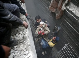 Syria Civil Defence members help an unconscious woman from a shelter in the besieged town of Douma, Eastern Ghouta, Damascus, Syria February 22, 2018.