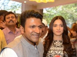 Puneeth Rajkumar, Tamannaah inaugurates Pothys showroom in Bengaluru on Feb 26, 2018.
