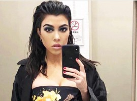Kourtney Kardashian shares bathroom selfie in Tiny crop top.