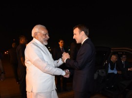 Modi breaks protocol, receives French President at airport.