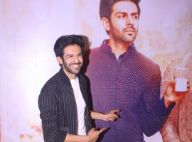 Kartik Aaryan poses for the photographers during Sonu Ke Titu Ki Sweety success party.