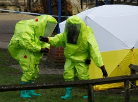 The forensic tent, covering the bench where Sergei Skripal and his daughter Yulia were found, is repositioned by officials in protective suits in the centre of Salisbury, Britain.