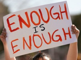 Columbine High School student Leah Zunder holds a sign during a National School Walkout in Littleton, Colorado.
