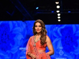 Actress Bipasha Basu showcases fashion designers Karishma and Deepa Sondhi's creation during the second day of Amazon India Fashion Week in New Delhi on March 15, 2018.