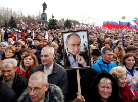 People attend a rally marking the fourth anniversary of Russia's annexation of Ukraine's Crimea region in the Black Sea port of Sevastopol, Crimea, March 14, 2018. As part of his campaign for re-election, President Vladimir Putin visited Crimea and addressed a crowd of cheering supporters with a speech that emphasised Russia's claim to the territory.