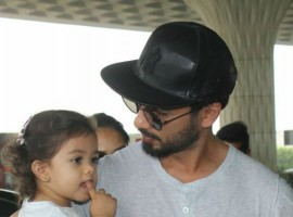Shahid Kapoor seen at the airport this morning along with daughter Misha.