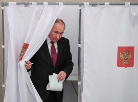 Russian President and presidential candidate Vladimir Putin is seen at a polling station during the presidential election in Moscow, Russia March 18, 2018.