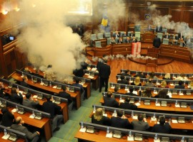 Kosovo opposition politicians release tear gas in parliament to obstruct a session in Pristina, Kosovo.