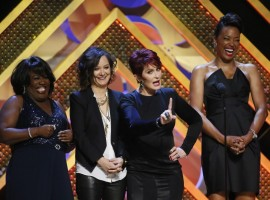 (L-R) The cast of The Talk, Sheryl Underwood, Sara Gilbert, Sharon Osbourne and Aisha Tyler, present the Outstanding Game Show host award at the 42nd Annual Daytime Emmy Awards
