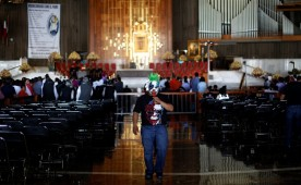 A Mexican wrestler known as Mini Psycho walks inside the Basilica of Our Lady Guadalupe during the annual lucha libre pilgrimage in Mexico City, Mexico August 25, 2016.