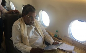 """Cauvery Issue: Siddaramaiah on the way to Delhi to meet Tamil Nadu Ministers. CM of Karnataka took to micro-blogging site Twitter and posted the image and wrote: """"Preparing for the meeting with Tamil Nadu on my way to Delhi."""""""
