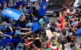 Various activist and Indigenous People's (IP) groups clash with anti-riot policemen during a protest against the continuing presence of U.S. troops in the Philippines in front of the U.S. Embassy in metro Manila.
