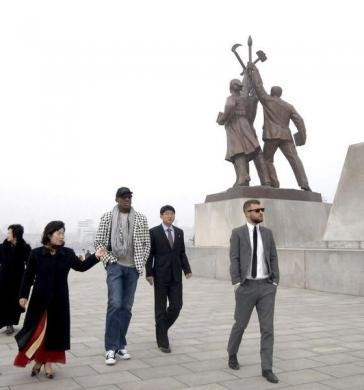 Dennis Rodman and his company visit the Tower of Juche Idea in Pyongyang in this picture released March 1, 2013. REUTERS