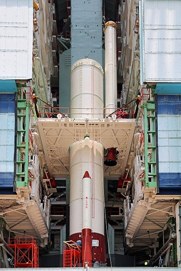 7 The strap on being lowered to its position during vehicle integration