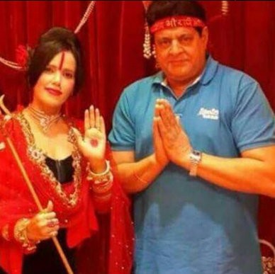 Radhe Maa,Radhe maa photos,Radhe maa photos with subhas gai,subhash ghai defends radhe maa,Radhe maa in dress,Radhe Maa in mini skirt,radhe maa hot pics,hot photos of radhe maa,Film Director Subhash Ghai hugging Radhe Maa,viral photos,FTII Chairman Gajend