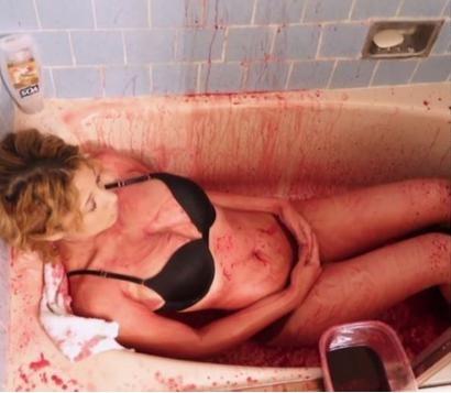 Californian model Chanel takes bath in pig blood