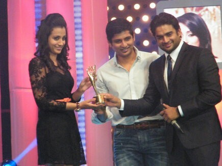 Actress Trisha receiving award from actors Madhavan and Jiiva