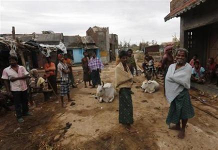 Fishermen outside their damaged houses in Ganjam district, Odisha