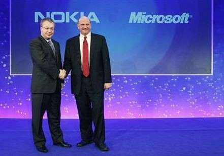 Nokia chief executive Stephen Elop (L) welcomes Microsoft chief executive Steve Ballmer with a handshake at a Nokia event in London in this February 11, 2011 file photograph.