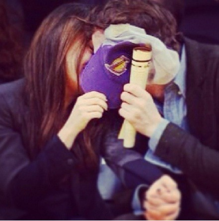 Mila Kunis and Ashton Kutcher share a public kiss