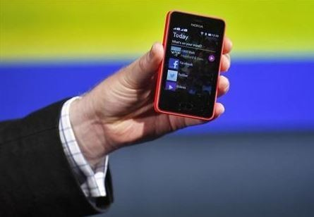 A Nokia official displays a new $99 phone in its mid-range Asha line at a launch in New Delhi May 9, 2013.