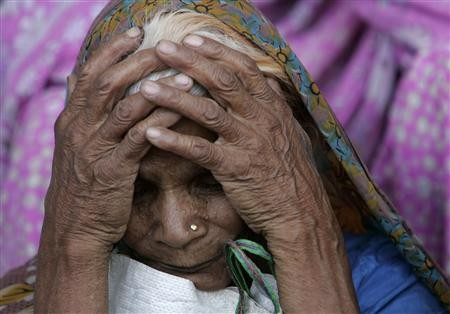 A victim of Bhopal gas tragedy attends a demonstration in Bhopal