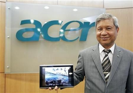 Acer's Chairman J.T. Wang poses with the new 10-inch Acer tablet PC after an interview with Reuters in Taipei December 14, 2010.