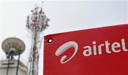 A Bharti Airtel advertisement board is installed against the backdrop of company's telecommunication tower in Kochi November 30, 2012.