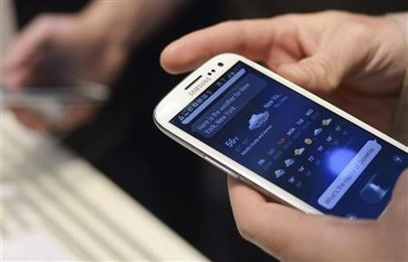 A man uses Samsung Electronics new Samsung Galaxy SIII smartphone during its launch at The Earls Court Exhibition Centre in London