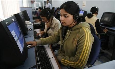 Employees at a call centre provide service support to customers in Siliguri.