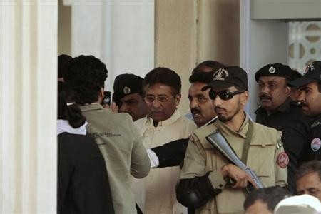 Pakistan's former President Pervez Musharraf (C) leaves after his appearance before the High Court in Rawalpindi April 17, 2013.