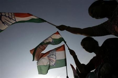 Supporters of Congress party wave party flags at an election rally in Bangalore. (Representational Image)