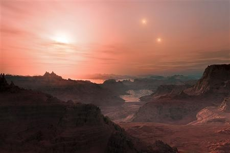 This artist's impression shows a sunset seen from the super-Earth Gliese 667 Cc.