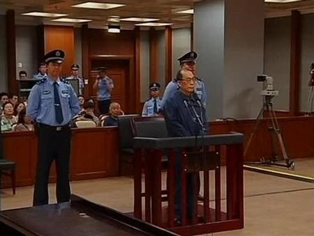 China's former railways minister, Liu Zhijun, attends a trial for charges of corruption and abuse of power at a courthouse in Beijing in this still image taken from video dated June 9, 2013.