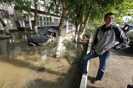 (Representational image) A local resident stands near a damaged car stuck in a flooded street in the town of Krymsk in Krasnodar region, southern Russia, July 8, 2012.