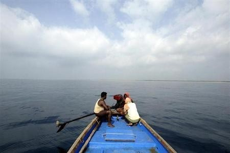 Fishermen in a boat in Bay of Bengal
