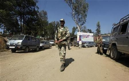 Security force personnel patrol a road at a village in the Chandel district,Imphal January 23, 2012.
